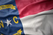 Waving Colorful Flag Of North Carolina State.