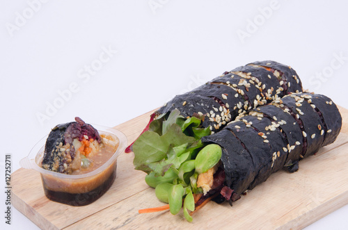 Foto op Canvas Krokodil Japanese sushi with black rice and vegetable in sauce