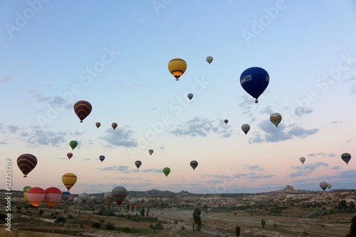 Poster Montgolfière / Dirigeable Waking up on launch site of Hot Air Balloons in Cappadocia