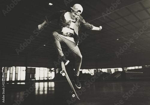 Boy Skateboarding Jump Lifestyle Hipster Concept Canvas Print