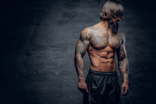 Hipster Male With Tattooed Muscular Body.