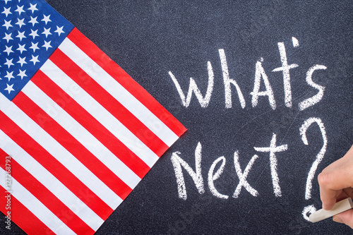 Photo  What's next on the chalk board and US flag