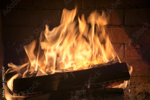 Poster Fire / Flame burning firewood in a fireplace