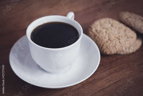 Spoed Foto op Canvas Chocolade fresh cup of coffee and biscuits for breakfast on a wooden table
