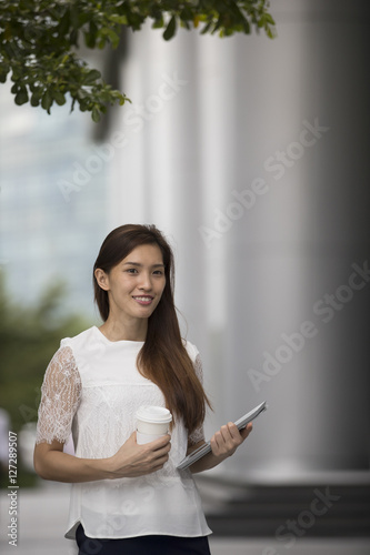 Asian business woman using a digital tablet. Poster