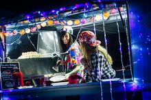 Two Female Vendors In Van