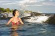 Woman enjoying last sunshine in water