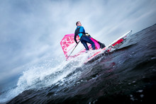 Windsurfer Carves And Tilts Th...