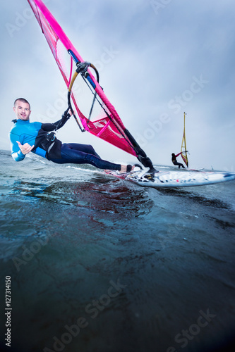 windsurfer greeting with shaka