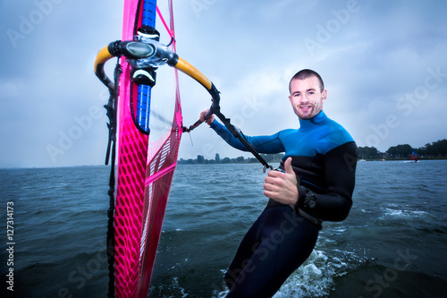 happy windsurfer gives a thumbs up