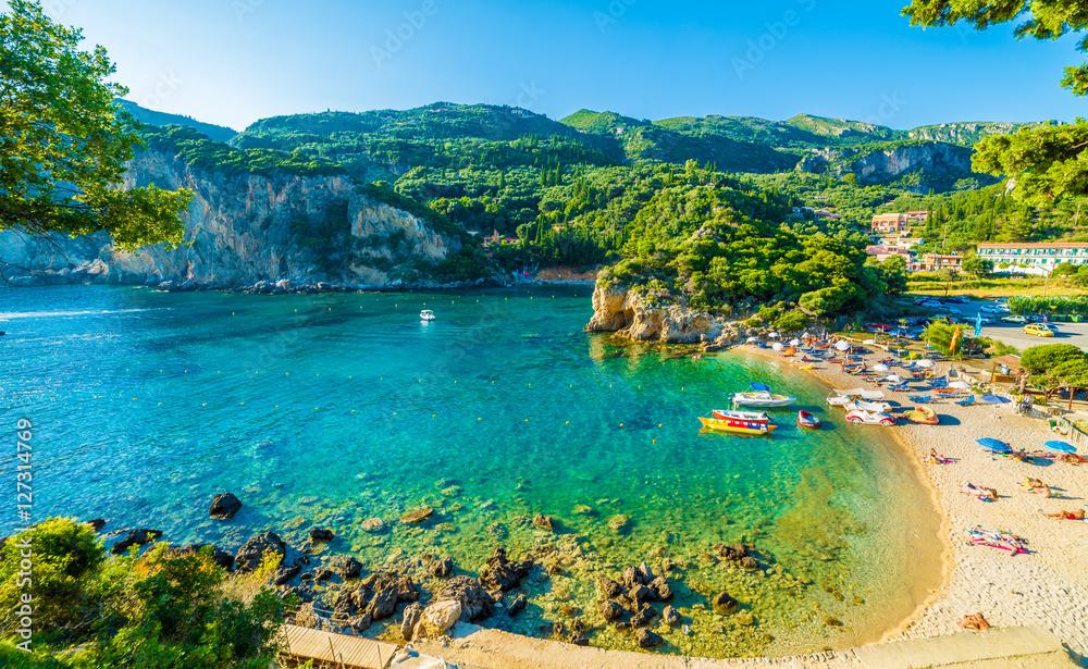 Fototapeta Beautiful beach and boat in Paleokastritsa, Corfu island, Greece