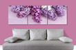 Floral wallpaper, lilac flowers collage above modern couch, Interior decor idea mock up