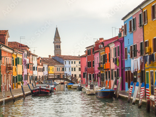 colorful street of burano island in venice, italy Plakat