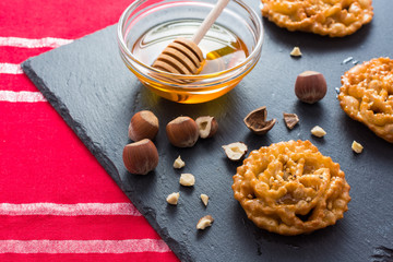 Cartellate, with honey and hazelnuts, traditional dessert of Puglia, Italy.