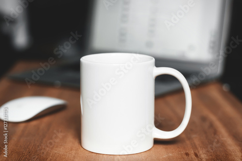 White mug on the desktop