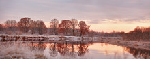 Cloudy And Sunny Autumn Dawn. First Snow On The Autumn River. Oa