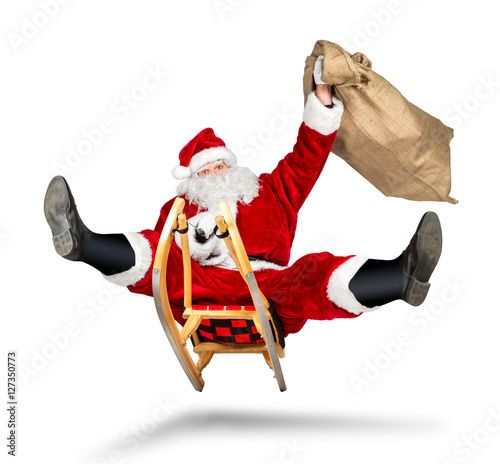 Fotografía  santa claus jumping on a sleigh crazy fast funny with his bag on christmas gift