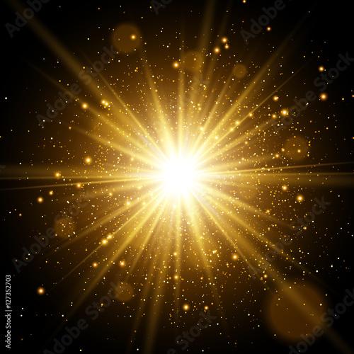 Photo  Light effect. Star burst with sparkles. Gold glitter texture