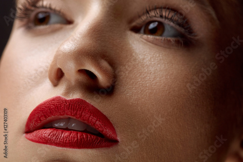 Close-up Of Beauty Woman Face With Beautiful Makeup And Red Lips Plakat