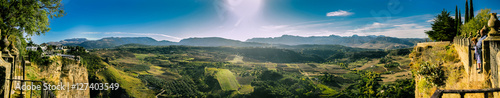 Panorama from the nature of Ronda with a low shining Sun, Andalusia, Spain
