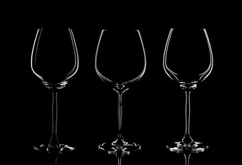 3 Bohemian crystal glasses, isolated on a black background, shooting in the studio
