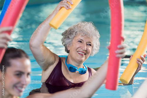 Senior woman doing aqua aerobic