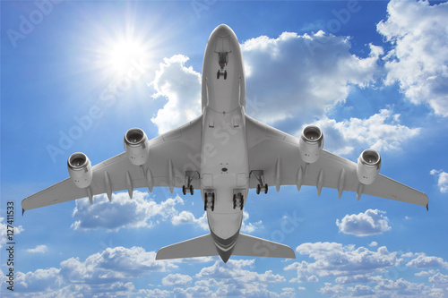 Bottom view airplane takeoff to the sky Canvas Print