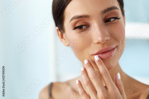 Lips Skin Care. Woman With Beauty Face Applying Lip Balm On Canvas Print