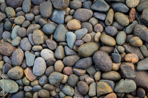 Poster Stenen Natural colorful stone on the beach, outdoor day light