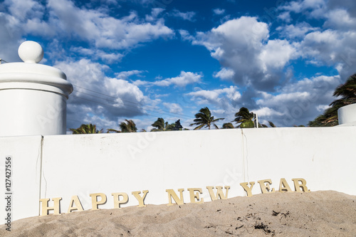 happy new year from floridahappy new year wooden sign at beach and beautiful blue