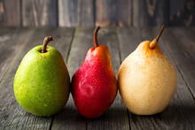Red, Green, Yellow Sweet Pears On A Dark Background. Selective Fokus.Rustik Style.