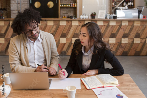 Two co-workers having discussion