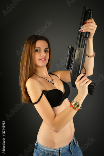 фотография  beautiful sexy girl holding gun