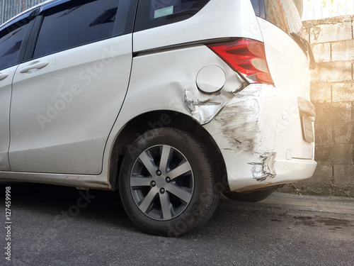 Fotografie, Obraz  Details of a white car in an accident, Car crash, insurance, soft focus, light effect