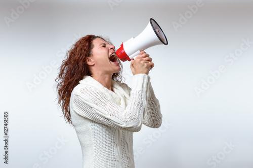 Fotografía Young woman shouting into a megaphone