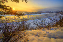 Beautiful Frosty Sunset On Frozen River Watching From Winter For