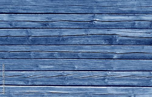 Fotografia, Obraz  Weathered blue color log house wall.