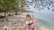 Girl playing the swing on beach.