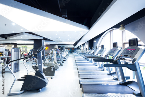 Poster Fitness equipment in modern gym