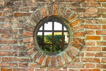 Old Round Window On Brick Wall