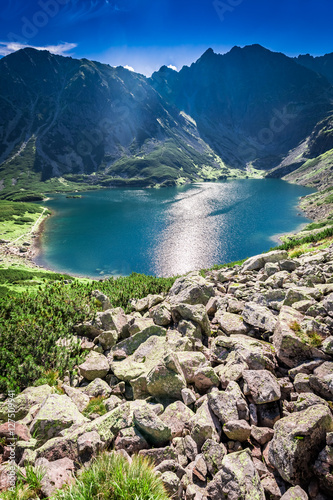 Foto op Canvas Bleke violet Beautiful Czarny Staw Gasienicowy at dawn in summer, Tatras