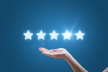 Businesswoman Hand Holding Five Stars Isolated On Blue Background