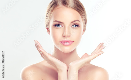 fototapeta na szkło Beautiful Young Woman with clean fresh skin . Facial treatment . Cosmetology , beauty and spa .