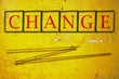 change writen on a wall background
