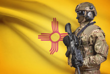 Soldier In Helmet Holding Machine Gun With USA State Flag On Background Series - New Mexico