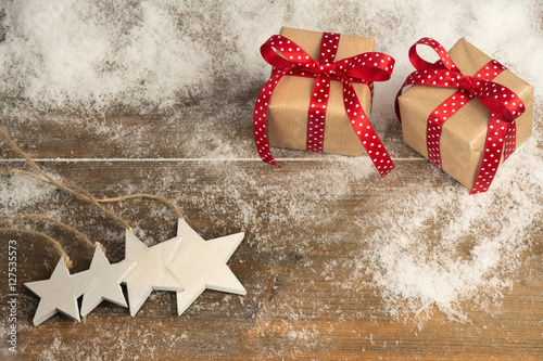 christmas gifts stars ornaments on wooden floor