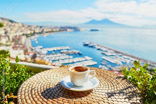 Spoed Foto op Canvas Napels Cup of coffee with view on Vesuvius mount in Naples