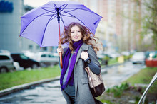 Portrait Of Pregnant Woman With Umbrella In The Rain, Grey Coat, Long Blond Curly Hair.