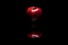 Red Apple Isolated On Black Background