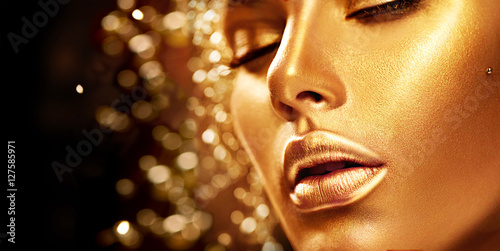 Beauty model girl with golden skin. Fashion art portrait